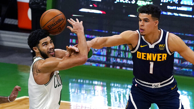 Denver Nuggets forward Michael Porter Jr. (1) knocks the ball from the hands of Boston Celtics forward Jayson Tatum, left, during the first half of an NBA basketball game Tuesday, Feb. 16, 2021, in Boston. (AP Photo/Charles Krupa)