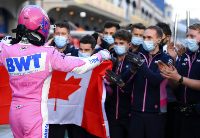 Racing Point driver Lance Stroll of Canada, front, celebrates his pole position with his team's mechanics after the qualifying session at the Istanbul Park circuit racetrack in Istanbul, Saturday, Nov. 14, 2020. The Formula One Turkish Grand Prix will take place on Sunday. (Clive Mason/Pool via AP)