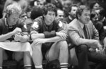 FILE - In this Dec. 21, 1982, file photo, Boston Celtics coach Bill Fitch and players Rick Robey, center, and Larry Bird watch from the bench as their team loses to the Philadelphia 76ers 122-105 in an NBA basketball game Philadelphia. Fitch is among 13 finalists for enshrinement later this year into the Basketball Hall of Fame. (AP Photo/Peter Morgan, File)