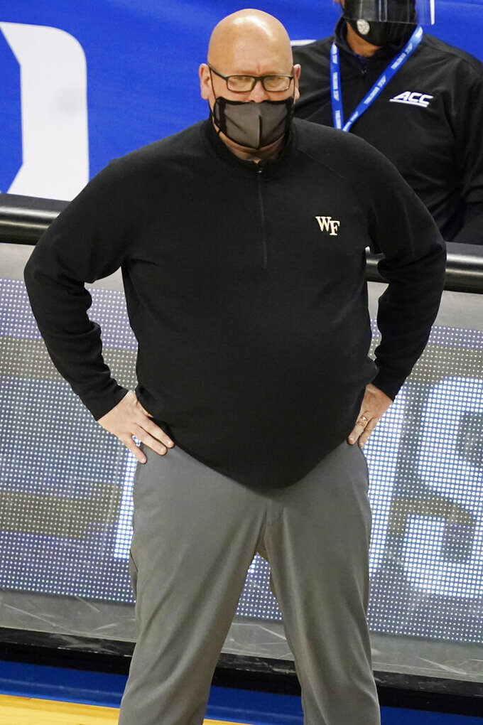 Wake Forest head coach Steve Forbes watches play during the second half of an NCAA college basketball game in the first round of the Atlantic Coast Conference tournament in Greensboro, N.C., Tuesday, March 9, 2021. (AP Photo/Gerry Broome)