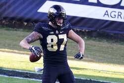 Purdue tight end Payne Durham (87) celebrates a touchdown against Rutgers during the first quarter of an NCAA college football game in West Lafayette, Ind., Saturday, Nov. 28, 2020. (AP Photo/Michael Conroy)