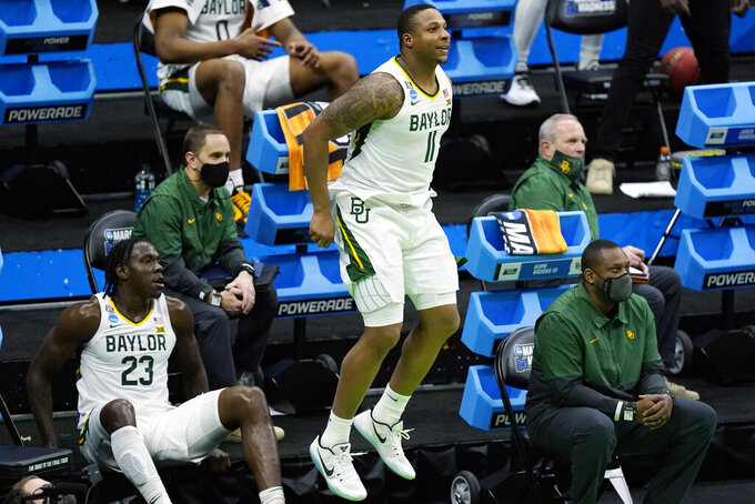Baylor's Mark Vital (11) celebrates a teammate's score late in the second half of a win against Hartford in a college basketball game in the first round of the NCAA tournament at Lucas Oil Stadium in Indianapolis Friday, March 19, 2021, in Indianapolis, Tenn. (AP Photo/Mark Humphrey)