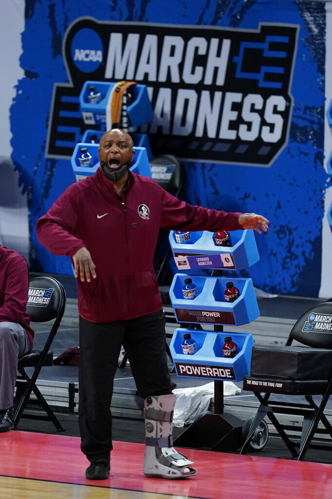 Florida State head coach Leonard Hamilton shouts during the first half of a first-round game against UNC-Greensboro in the NCAA men's college basketball tournament at Banker's Life Fieldhouse, Saturday, March 20, 2021, in Indianapolis. (AP Photo/Darron Cummings)