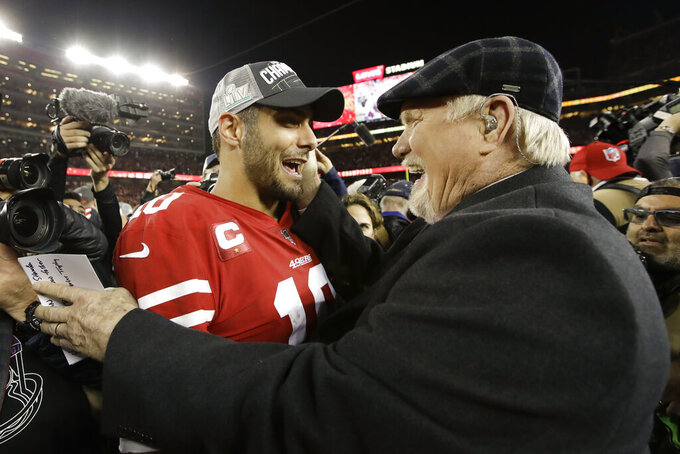 San Francisco 49ers quarterback Jimmy Garoppolo celebrates with Terry Bradshaw after their win against the Green Bay Packers in the NFL NFC Championship football game Sunday, Jan. 19, 2020, in Santa Clara, Calif. The 49ers won 37-20 to advance to Super Bowl 54 against the Kansas City Chiefs. (AP Photo/Marcio Jose Sanchez)