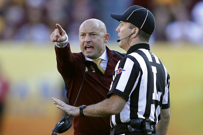 Minnesota head coach P.J. Fleck points at the screen as he yells at line judge Jim Slayton during the second half of the Outback Bowl NCAA college football game against Auburn Wednesday, Jan. 1, 2020, in Tampa, Fla. (AP Photo/Chris O'Meara)