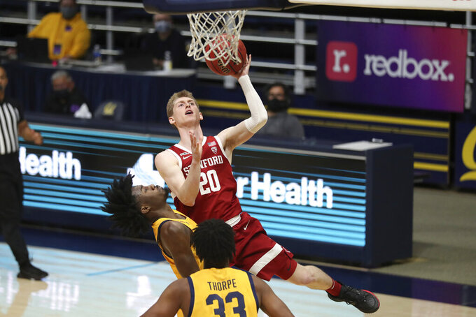 Stanford guard Noah Taitz shoots against California guard guard Joel Brown, left, during the first half of an NCAA college basketball game in Berkeley, Calif., Thursday, Feb. 4, 2021. (AP Photo/Jed Jacobsohn)