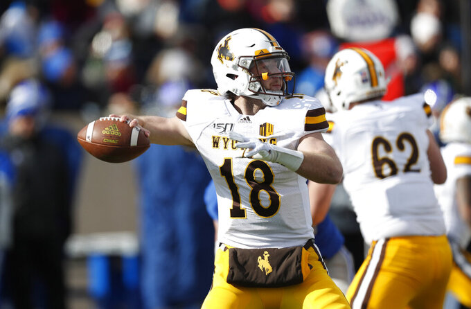 Wyoming quarterback Tyler Vander Waal drops back to pass against Air Force in the first half of an NCAA college football game Saturday, Nov. 30, 2019, at Air Force Academy, Colo. (AP Photo/David Zalubowski)