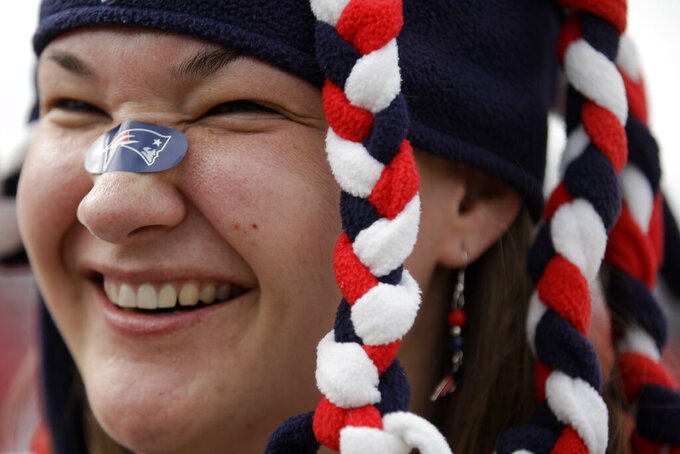 Sue Sironi of Salem, Mass., smiles as she waits in a line near the Mercedes-Benz Stadium, Sunday, Feb. 3, 2019, in Atlanta, ahead of the NFL Super Bowl 53 football game between the Los Angeles Rams and New England Patriots. (AP Photo/Matt Rourke)