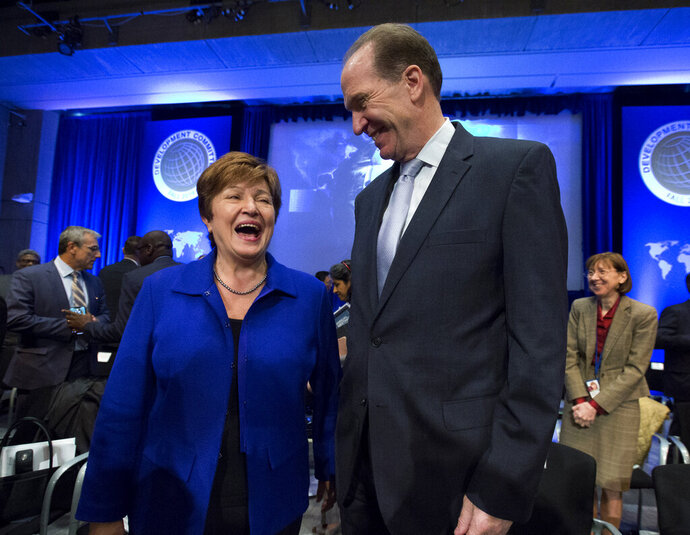 International Monetary Fund Managing Director Kristalina Georgieva speaks with World Bank President David Malpass during the Development Committee plenary at the World Bank/IMF Annual Meetings in Washington, Saturday, Oct. 19, 2019. (AP Photo/Jose Luis Magana)