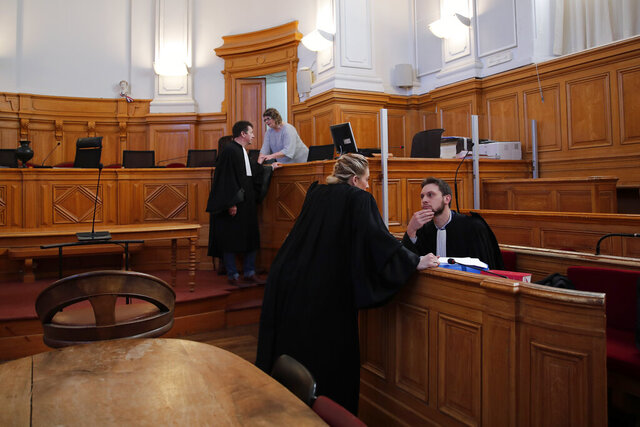 French lawyer Thibaut Kursawa, right, defending retired French surgeon Joel Le Scouarnec attends the opening day of the trial in the courthouse of Saintes, western France, Friday, March 13, 2020. A retired French surgeon accused of raping or sexually abusing more than 300 girls – often on the operating table - goes on trial, in a case that took decades to come to light and may be France's worst single sexual abuse case to date. (AP Photo/Francois Mori)