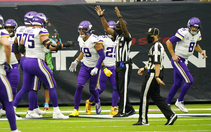 Minnesota Vikings wide receiver Adam Thielen (19) and quarterback Kirk Cousins (8) celebrates after they connected on a pass for a touchdown against the Houston Texans during the second half of an NFL football game Sunday, Oct. 4, 2020, in Houston. (AP Photo/David J. Phillip)