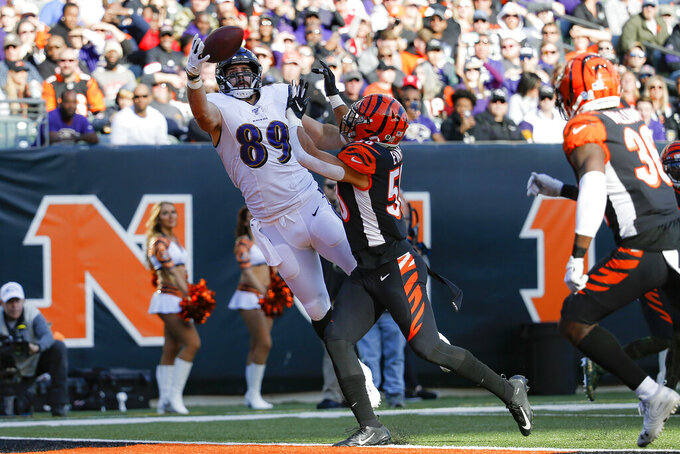 Cincinnati Bengals outside linebacker Jordan Evans (50) breaks up a pass to Baltimore Ravens tight end Mark Andrews (89) during the second half of NFL football game, Sunday, Nov. 10, 2019, in Cincinnati. (AP Photo/Frank Victores)