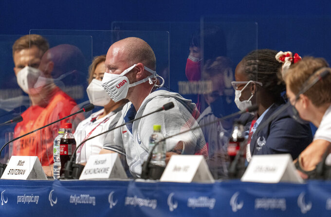Matt Stutzman, center, of the U.S. answers media questions at a news conference ahead of the 2020 Summer Paralympics in Tokyo, Japan, Sunday, Aug. 22, 2021. (Josh Toth for OIS via AP)