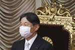 Japan's Emperor Naruhito wearing a face mask to protect against the coronavirus attends to formally open an extraordinary Diet session at the upper house of parliament in Tokyo, Monday, Oct. 26, 2020. (AP Photo/Koji Sasahara)