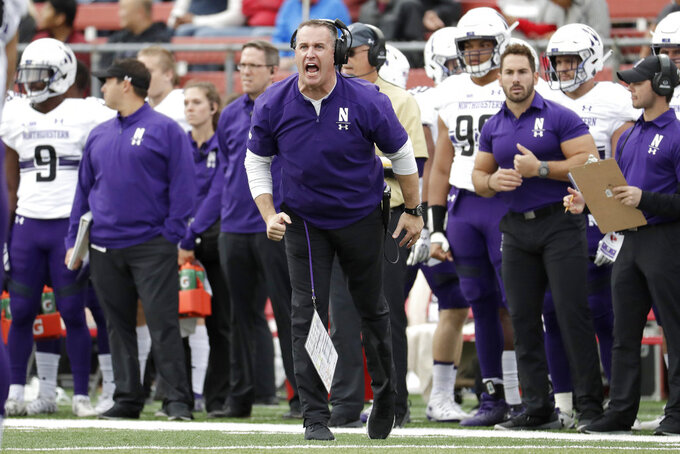 FILE - In this Saturday, Oct. 20, 2018, file photo, Northwestern head coach Pat Fitzgerald talks to his team during the first half of an NCAA college football game against Rutgers, in Piscataway, N.J. Northwestern takes on Wisconsin, Saturday, Oct. 27. (AP Photo/Julio Cortez, File)