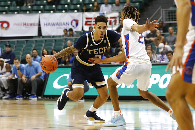Georgia Tech guard Jose Alvarado (10) tries to get past Boise State guard Derrick Alston (21) during the second half of an NCAA college basketball game Sunday, Dec. 22, 2019, in Honolulu. (AP Photo/Marco Garcia)
