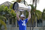 Tampa Bay Lightning center Steven Stamkos hoists the Stanley Cup during the NHL hockey Stanley Cup champions' Boat Parade, Monday, July 12, 2021, in Tampa, Fla. (AP Photo/Phelan M. Ebenhack)
