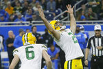 Green Bay Packers kicker Mason Crosby (2) raises his arms after kicking the winning field goal during the second half of an NFL football game against the Detroit Lions, Sunday, Dec. 29, 2019, in Detroit. (AP Photo/Duane Burleson)