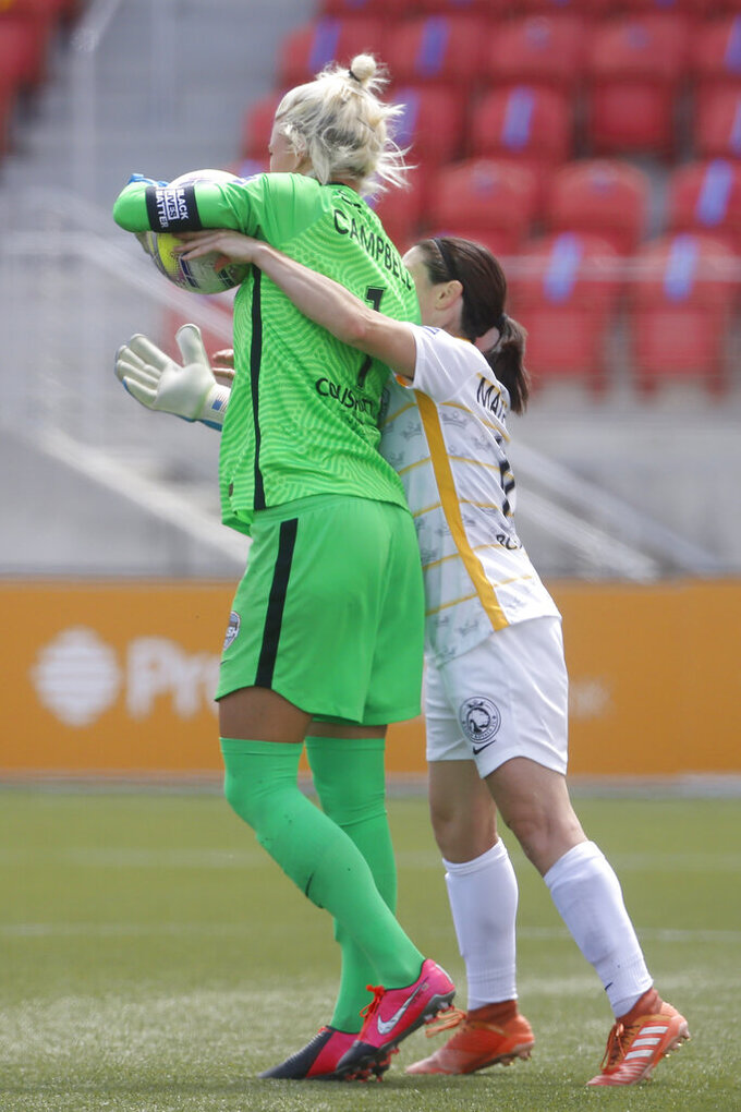 Utah Royals FC midfielder Diana Matheson, right, tries to take the ball from Houston Dash goalkeeper Jane Campbell (1) during the second half of an NWSL Challenge Cup soccer match at Zions Bank Stadium Tuesday, June 30, 2020, in Herriman, Utah. Matheson received a yellow card. (AP Photo/Rick Bowmer)