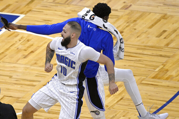Orlando Magic guard Evan Fournier (10) celebrates with center Mo Bamba after making a 3-point basket during the second half of the team's NBA basketball game against the New York Knicks, Wednesday, Feb. 17, 2021, in Orlando, Fla. (AP Photo/Phelan M. Ebenhack)