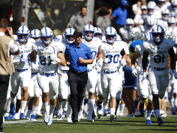 Air Force head coach Troy Calhoun, center, leads his players onto the field for an NCAA college football game against Colorado, Saturday, Sept. 14, 2019, in Boulder, Colo. (AP Photo/David Zalubowski)
