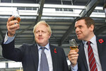FILE - In this file photo dated Nov. 7, 2019, showing Britain's Prime Minister Boris Johnson alongside Douglas Ross, parliamentary under-secretary of state for Scotland, right in Moray, Scotland.   Junior British government minister Douglas Ross has quit Tuesday May 26, 2020, over Prime Minister Boris Johnson's failure to fire his top aide Dominic Cummings for allegedly breaching COVID-19 coronavirus lockdown rules. (Stefan Rousseau / PA via AP)