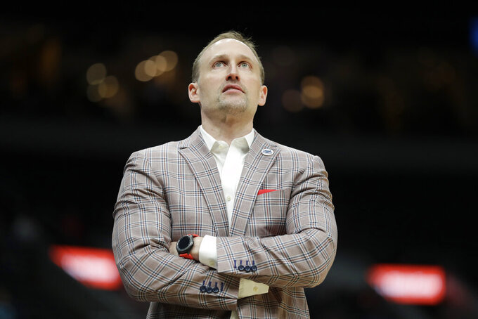 Illinois State head coach Dan Muller is seen on the sidelines during the first half of an NCAA college basketball game against Drake in the first round of the Missouri Valley Conference men's tournament Thursday, March 5, 2020, in St. Louis. (AP Photo/Jeff Roberson)