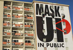 A billboard is installed on an apartment building encouraging people to wear face masks in Cape Town, South Africa, Saturday, May 16, 2020, marking day 51 of a strict government lockdown in a bid to prevent the spread of coronavirus. The Western Cape province which includes the city of Cape Town, has emerged as the country's coronavirus hotspot, accounting for more than half of the nation's confirmed cases. (AP Photo/Nardus Engelbrecht)