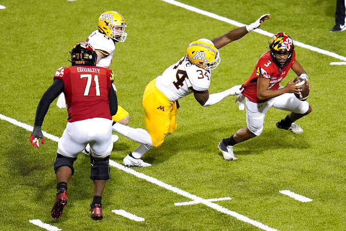 Minnesota defensive lineman Boye Mafe (34) sacks Maryland quarterback Taulia Tagovailoa (3) during the second half of an NCAA college football game, Friday, Oct. 30, 2020, in College Park, Md. Maryland won 45-44 in overtime. (AP Photo/Julio Cortez)