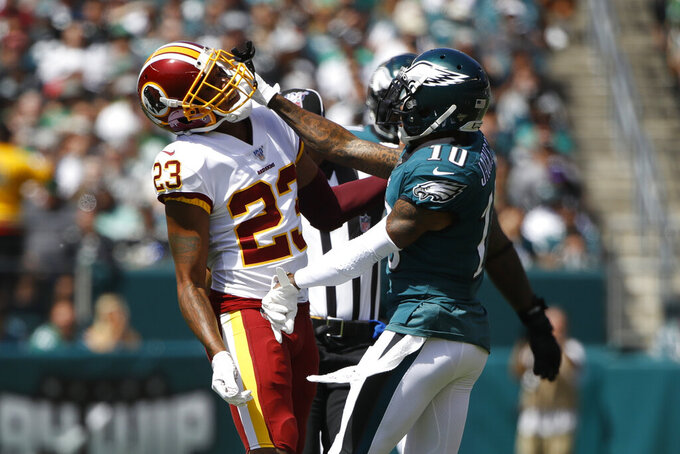 Washington Redskins' Quinton Dunbar, left, and Philadelphia Eagles' DeSean Jackson scuffle during the first half of an NFL football game, Sunday, Sept. 8, 2019, in Philadelphia. (AP Photo/Matt Rourke)