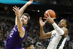Michigan State forward Xavier Tillman (23) catches the inbound pass intended for Northwestern guard Pat Spencer (12) during the first half of an NCAA college basketball game, Wednesday, Jan. 29, 2020, in East Lansing, Mich. (AP Photo/Carlos Osorio)