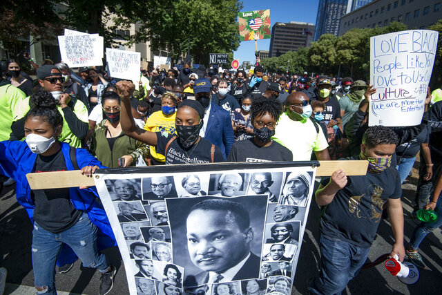Thousands of protesters march down Capitol Mall in Sacramento, Calif., on Saturday, June 6, 2020. The protest is sparked by the death of George Floyd, who died May 25 after he was restrained by Minneapolis police. (Jason Pierce/The Sacramento Bee via AP)