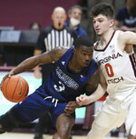 Longwood's DeShaun Wade (3) drives against Virginia Tech's Hunter Cattoor (0) in the second half of an NCAA college basketball game in Blacksburg, Va., Monday, Dec. 21, 2020. (Matt Gentry/The Roanoke Times via AP, Pool)