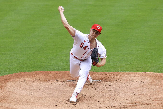 Cincinnati Reds' Sonny Gray throws during the first inning of a baseball game against the Cleveland Indians in Cincinnati, Saturday, April 17, 2021. (AP Photo/Aaron Doster)