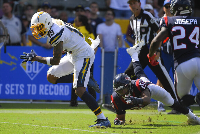 Los Angeles Chargers wide receiver Keenan Allen, left, scores ahead of Houston Texans cornerback Johnathan Joseph, right, and strong safety Justin Reid (20) during the first half of an NFL football game Sunday, Sept. 22, 2019, in Carson, Calif. (AP Photo/Mark J. Terrill)