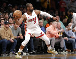 Miami Heat guard Dwyane Wade (3) prepares to pass the ball down court during the second half of the team's NBA basketball game against the Brooklyn Nets, Wednesday, April 10, 2019, in New York. It was the final game of Wade's NBA career. (AP Photo/Kathy Willens)