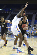 Colorado guard guard Shane Gatling, right, collides with UCLA forward Cody Riley during the first half of an NCAA college basketball game Thursday, Jan. 30, 2020, in Los Angeles. (AP Photo/Michael Owen Baker)