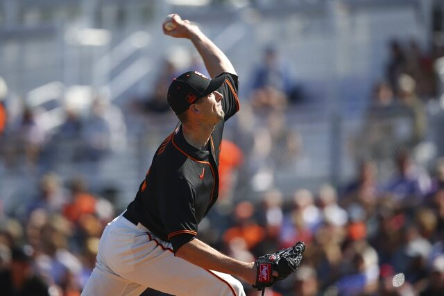 San Francisco Giants starting pitcher Drew Smyly throws against the Arizona Diamondbacks during the first inning of a spring training baseball game Monday, Feb. 24, 2020, in Scottsdale, Ariz. (AP Photo/Ross D. Franklin)