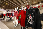 In this Tuesday, Nov. 5, 2019, photo browse holiday-themed clothing in the women's department at the Macy's flagship store in New York. With three weeks until the official start of the holiday shopping season, the nation's retailers are gearing up for what will be another competitive shopping period. (AP Photo/Richard Drew)