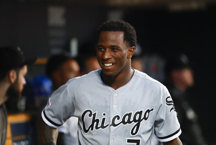FILE - In this Sept. 20, 2019, file photo, Chicago White Sox's Tim Anderson smiles in the dugout during the second inning of the team's baseball game against the Detroit Tigers in Detroit. Anderson landed a spot on a video game cover Thursday, Jan.21. He'd like a World Series ring to go with it. Anderson sees no reason why the White Sox can't win it all after loading up on the heels of a breakthrough playoff season. (AP Photo/Paul Sancya, File)