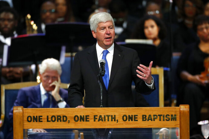 FILE - In this Aug. 31, 2018, file photo, Michigan Gov. Rick Snyder speaks during the funeral service for Aretha Franklin in Detroit. Flint residents whose health and homes were harmed by lead-contaminated water scored a legal milestone Wednesday, July 29, 2020 when the Michigan Supreme Court said they could proceed with a lawsuit against public officials for the disastrous decisions that caused the scandal. (AP Photo/Paul Sancya, File)