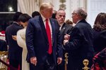 President Donald Trump speaks to attorney Alan Dershowitz, right, as he arrives for Christmas Eve dinner at Mar-a-lago in Palm Beach, Fla., Tuesday, Dec. 24, 2019. (AP Photo/Andrew Harnik)