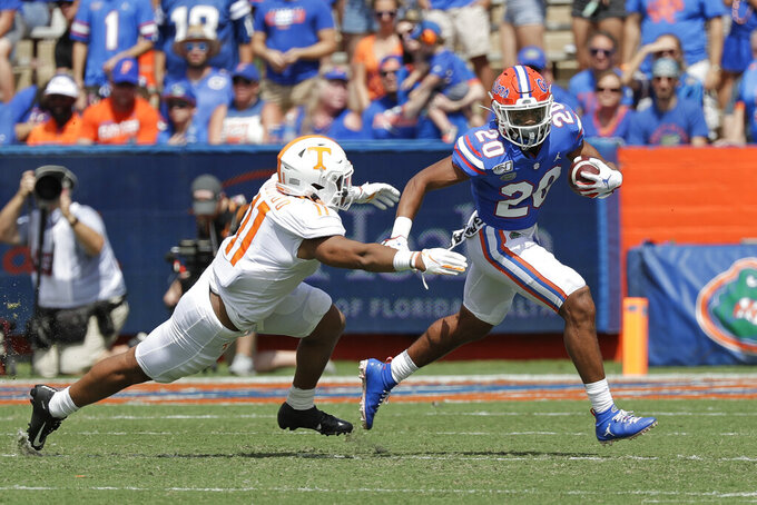 Florida running back Malik Davis (20) tries to get past Tennessee linebacker Henry To'o To'o, left, during the first half of an NCAA college football game, Saturday, Sept. 21, 2019, in Gainesville, Fla. (AP Photo/John Raoux)
