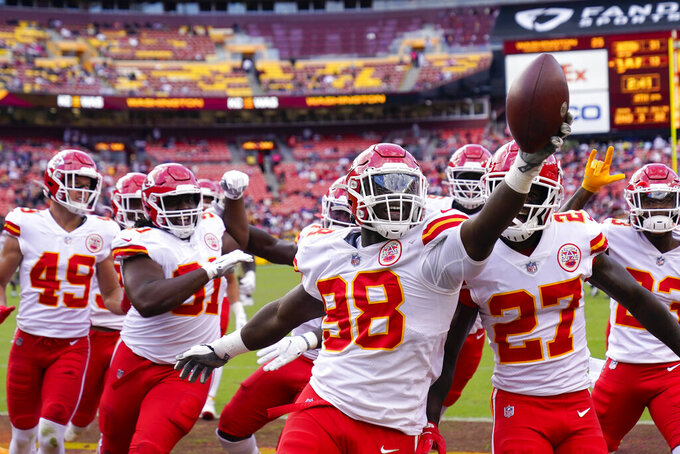 Kansas City Chiefs defensive end Tershawn Wharton (98) holds up the football as he celebration his interception against the Washington Football Team during the second half of an NFL football game, Sunday, Oct. 17, 2021, in Landover, Md. Chiefs won 31-13. (AP Photo/Alex Brandon)