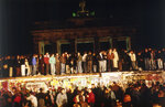 FILE - In this early morning, Nov. 10, 1989 file photo, Berliners from East and West crowd in front of the Brandenburger Tor (Brandenburg Gate), standing atop and below the Berlin Wall, which has divided the city since the end of World War II. (AP Photo/Jockel Finck)