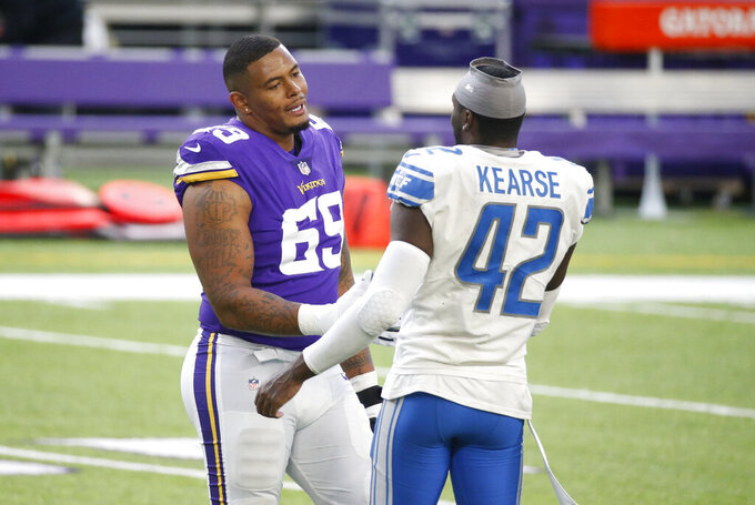 Minnesota Vikings offensive tackle Rashod Hill, left, talks with Detroit Lions safety Jayron Kearse (42) after an NFL football game, Sunday, Nov. 8, 2020, in Minneapolis. The Vikings won 34-20. (AP Photo/Bruce Kluckhohn)