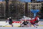 In this Feb. 4, 2017 file photo, the NHL hockey team Calgary Flames practices on Lasker Rink in New York's Central Park. Skaters may notice something missing from the park's two ice rinks this winter — President Donald Trump's name. The Trump Organization still operates the rinks but has removed the Trump name from the outer boards, the skate rental counters and elsewhere. (AP Photo/Craig Ruttle, File)