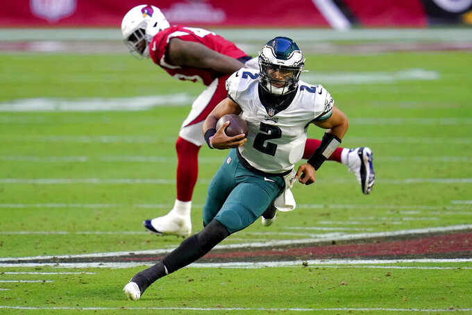 Philadelphia Eagles quarterback Jalen Hurts (2) scrambles against the Arizona Cardinals during the second half of an NFL football game, Sunday, Dec. 20, 2020, in Glendale, Ariz. (AP Photo/Ross D. Franklin)