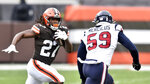 Cleveland Browns running back Kareem Hunt (27) rushes against Houston Texans outside linebacker Whitney Mercilus (59) during the first half of an NFL football game, Sunday, Nov. 15, 2020, in Cleveland. (AP Photo/David Richard)