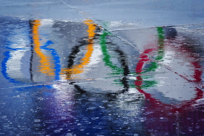The Olympic rings are seen reflected in water at the BMX Freestyle course after a training session was cancelled due to rain, at the 2020 Summer Olympics, Tuesday, July 27, 2021, in Tokyo, Japan. (AP Photo/Ben Curtis)